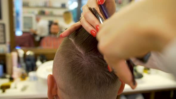 Thumbnail for Young Man Getting Haircut