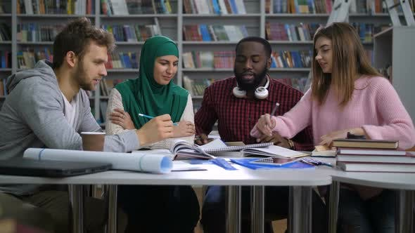 Thumbnail for Multiethnic Students Preparing To Exams in Library
