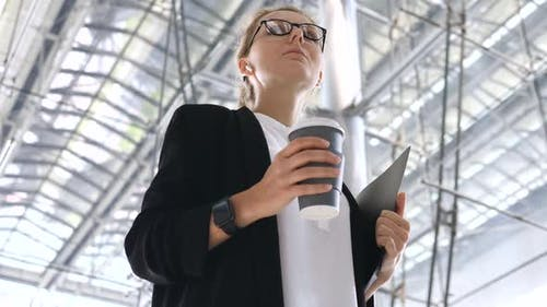 Business Technology Concept, Businesswoman In Wireless Earbuds And Smartwatch