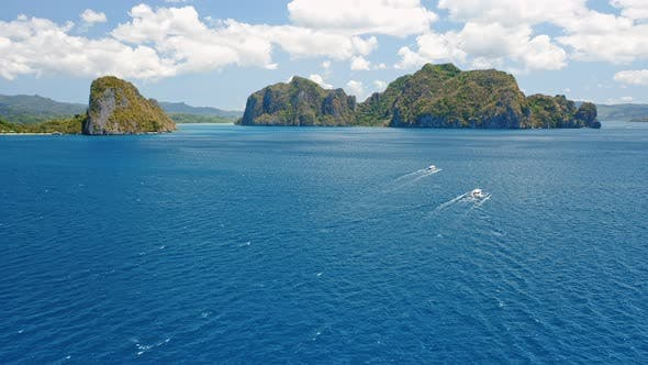 Thumbnail for El Nido, Palawan Island, Philippines. Aerial View of Island Hopping Tourist Boats in Open Ocean