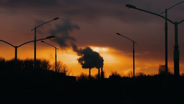 Thumbnail for Industrial Zone From City Pipe Thick Smoke is Poured From Factory Sunset, Pollute Atmosphere Smoke