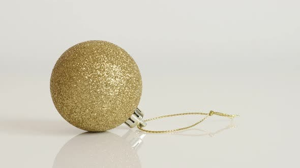 Thumbnail for Shiny bauble with sequins close-up 4K 2160p 30fps UltraHD tilting  footage - Gold color Christmas or