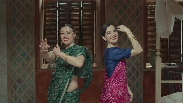 Pretty Females in Sari Dancing in Indian Manner