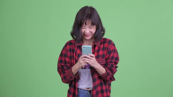 Thumbnail for Happy Asian Hipster Woman Using Phone