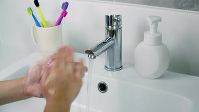 A Child Washes Hands with Soap Little Girl Hands Washing to Prevention Diffusion of Virus and