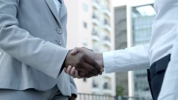 Thumbnail for Two Employees Shaking Hands Outdoor.