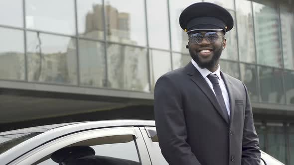 Cover Image for Personal Driver Giving Passers-By Sincere Smile Waiting for Boss from Airport