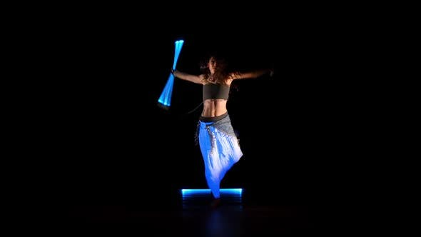 Thumbnail for Beautiful Gipsy Woman Dancing In Neon Light With Ultraviolet Staffs 1
