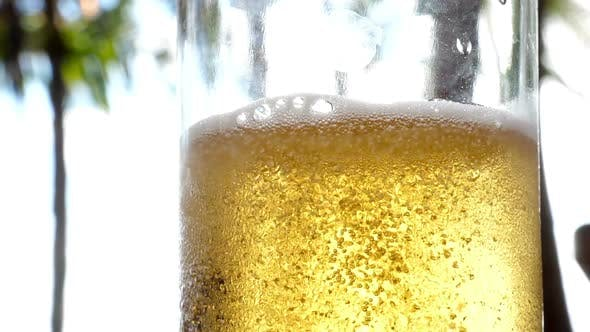 Thumbnail for Very Cold Beer Stream and Detail of the Bubbles