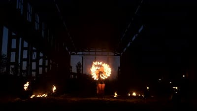 Professional Fire Show in the Old Hangar of the Aircraft Show Professional Circus Artists Three