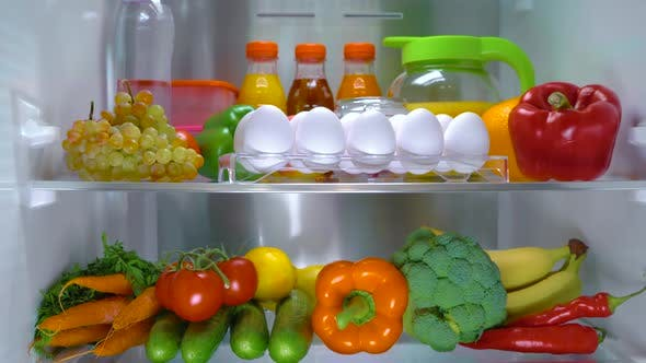 Thumbnail for Open Refrigerator Filled with Food