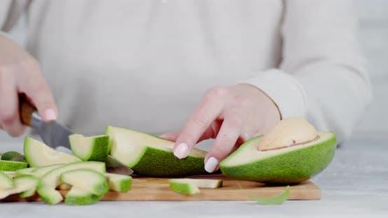 Sliced Fresh Avocado on a Cutting Board.