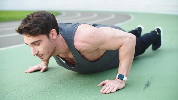 Thumbnail for Sport Man Doing Push Up Exercise at Stadium. Fitness Man Doing Pushups Exercise