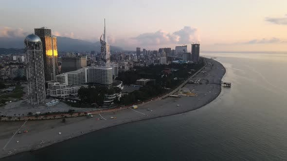 Aerial shot of alphabetic tower, skyscrapers and embankment of beautiful city of Batumi, Georgia