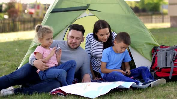 Husband and Wife Camping with Kids in Back Yard