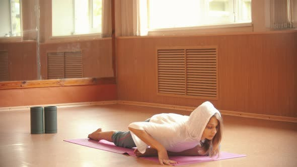Thumbnail for Young Woman Gymnast Warming Up Sitting on the Floor and Doing Stretching Exercises