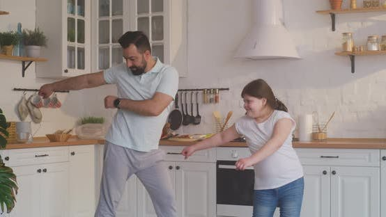 Thumbnail for Father and Daughter Dancing in the Kitchen