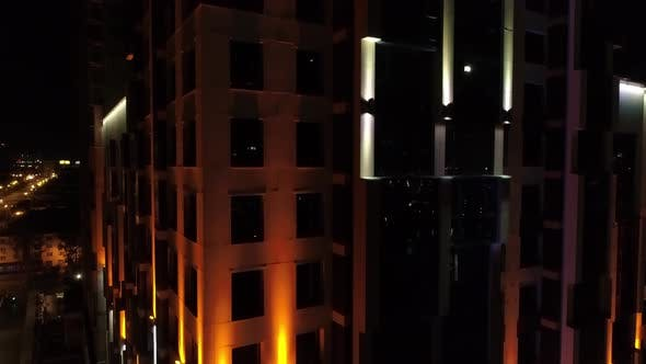 A modern building with beautiful colorful architectural illumination in night city 07