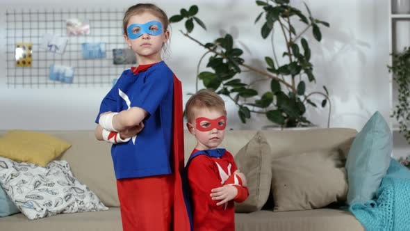 Thumbnail for Little Boy and Girl in Superhero Costumes Posing for Camera