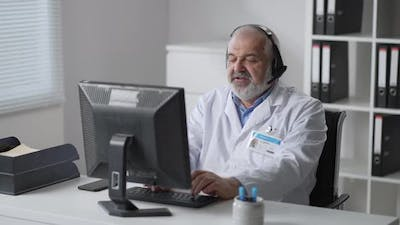 Physician Using Computer in Their Office Doctor Checking Medical Records