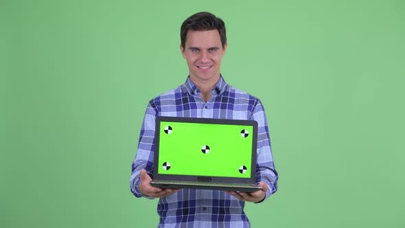 Thumbnail for Happy Young Handsome Hipster Man Showing Laptop and Looking Surprised