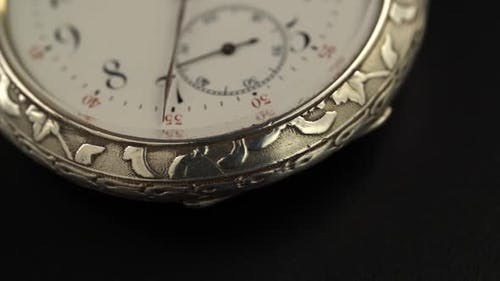 Old Silver Pocket Watch with the Second Moving.