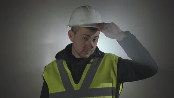 Thumbnail for Portrait Industrial Engineers in Hard Hat on a Black Background in the Spotlight