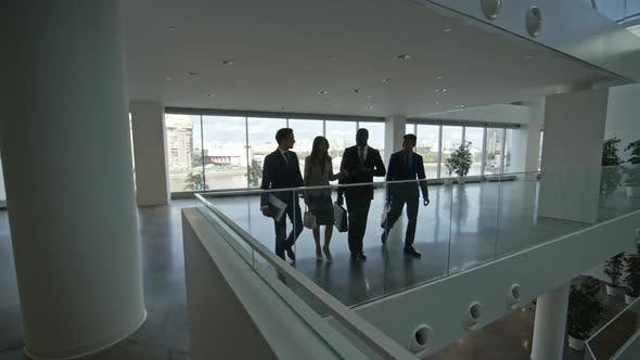 Thumbnail for Business Executives Speaking in Modern Conference Center