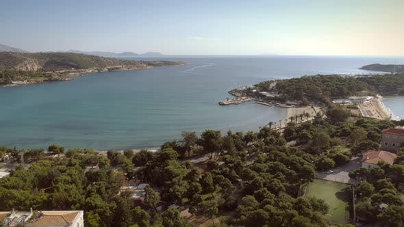 Thumbnail for Aerial view of relaxing residential area located at seaside in Greece.