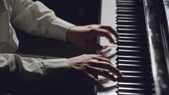 The Pianist Performs Playing a Grand Piano