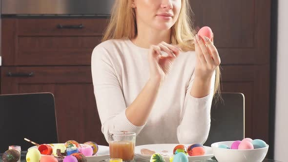 Thumbnail for Mother Decorating Easter Eggs for Holiday