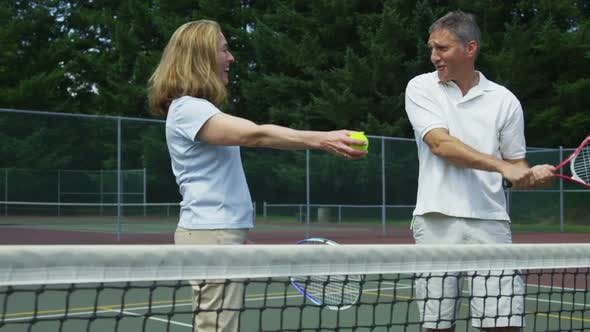 Thumbnail for Mature couple prepare to play tennis
