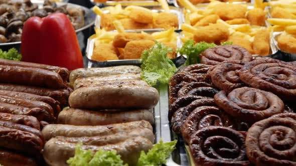 Thumbnail for Traditional Street Food. Grilled Food Lie on the Counter of a Street Market. Various Sausages