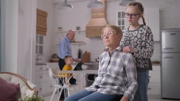 Cover Image for Caring Granddaughter Making Massage To Grandmother