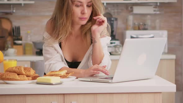 Sexy Housewife Using Laptop