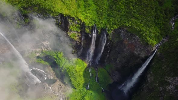 Thumbnail for Aerial view above waterfall surrounding by jungle, Faroe Island.
