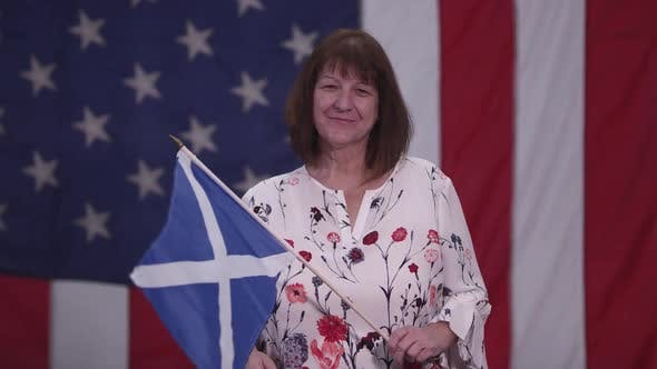 Woman waving Flag of Scottland