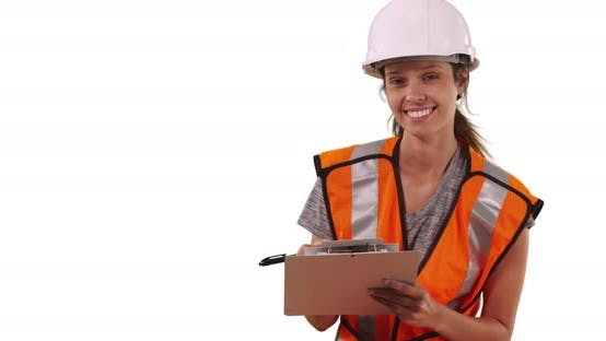 Thumbnail for Female construction worker in hardhat and safety vest smiling at camera on white