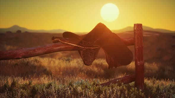 Old Saddle As the Sunset in the Country