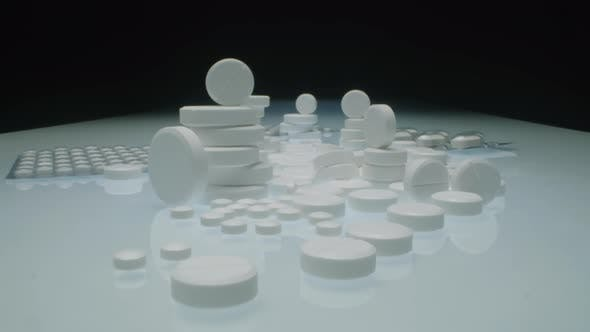 Thumbnail for Stacks of White Tablets and Blister Packs with Pills on Table
