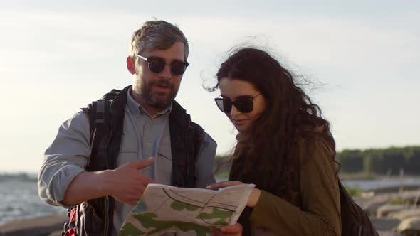 Thumbnail for Tourist Couple Discussing Route on Map