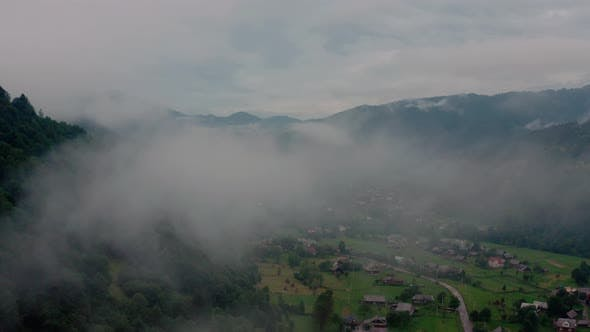Thumbnail for Aerial View Over Foggy Mountains After Rain