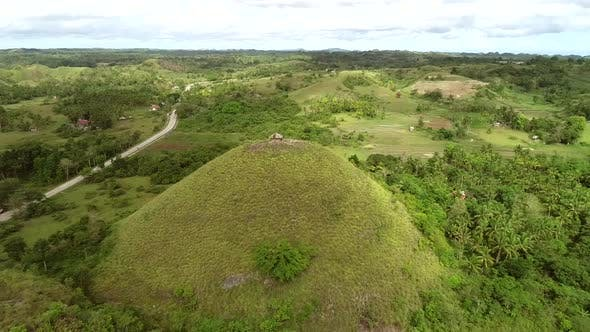 Thumbnail for Aerial view of house on the top of Chocolate Hills Complex, Batuan, Philippines.