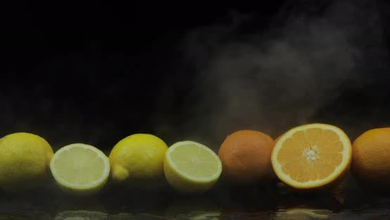 Thumbnail for Tropical Lemon and Orange in Cold Ice Clouds of Fog Smoke on Black Background
