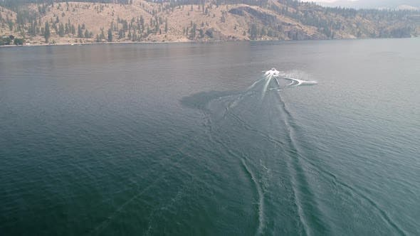 Thumbnail for Waterski Aerial Spraying Beautiful Blue Water Behind Boat
