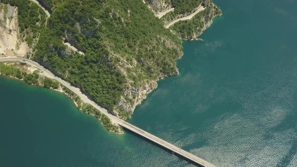 Thumbnail for Aerial Footage a Car Driving Over a Bridge on Piva Lake