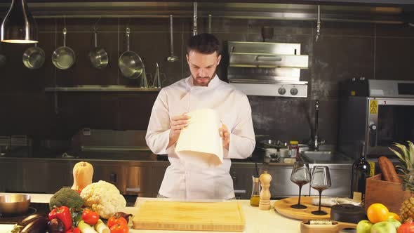 Portrait of Caucasian Male Chef in the Interior of Restaurant's Kitchen