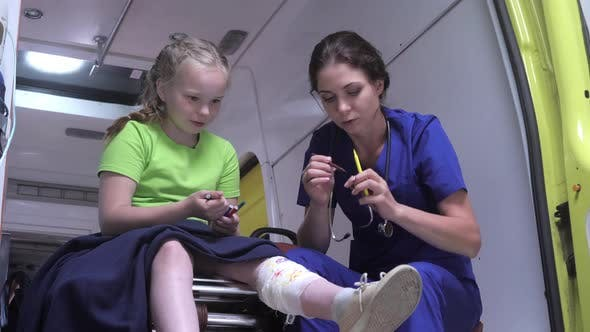 Thumbnail for Sick Girl Sit with Nurse in Ambulance Car.