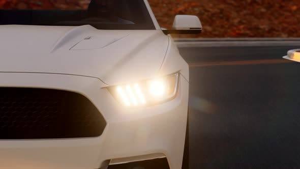 Thumbnail for Close-up White Sports Car on the Asphalt Road