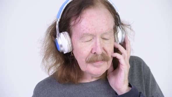 Thumbnail for Senior Man with Mustache Listening To Music